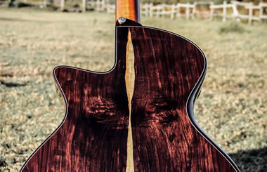handcrafted acoustic steel string guitar with bevelled edges